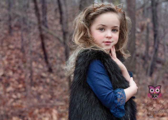 Gorgeous Child poses in the winter woods
