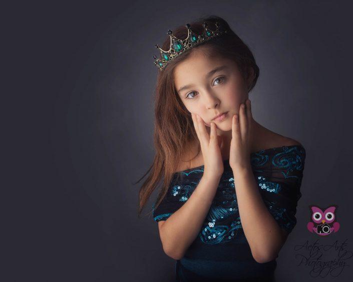 Beautiful little girl poses as a princess