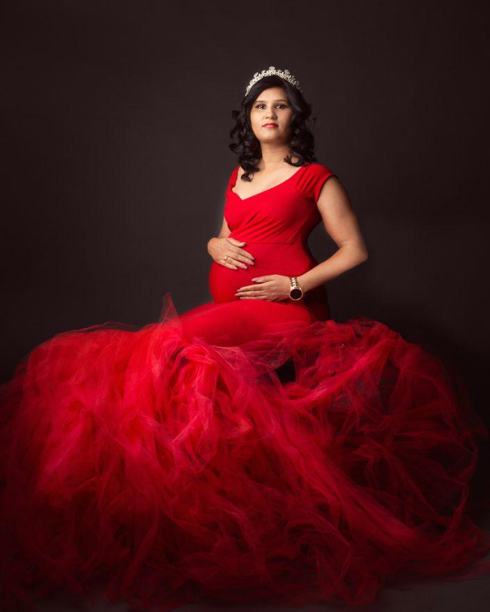 Elegant mother poses in studio