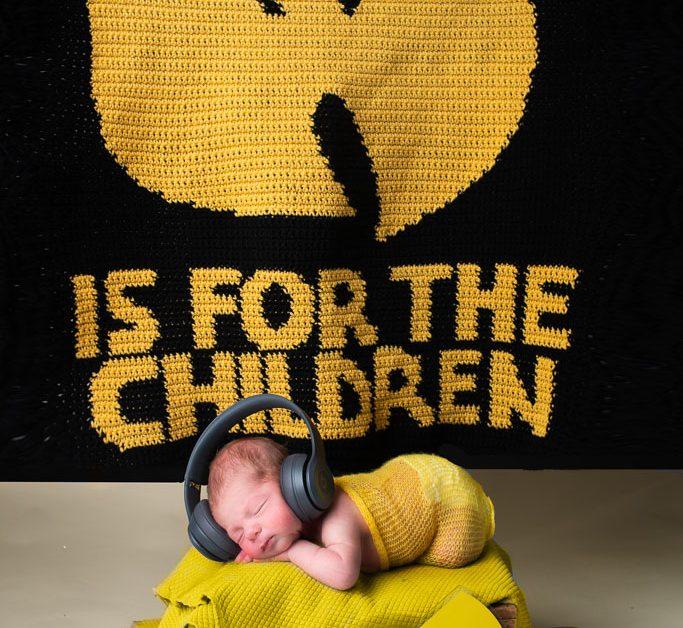 Sleepy Newborn Baby Boy on Wutang Blanket