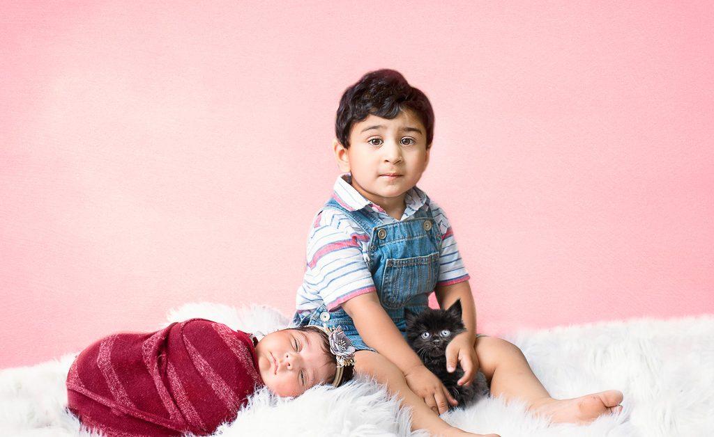 Darling siblings pose together at newborn session